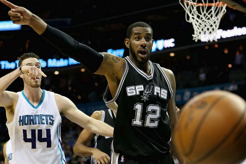 LaMarcus Aldridge (right) of the San Antonio Spurs and Frank Kaminsky (left) of the Charlotte Hornets during a game in Charlotte, North Carolina, on March 21.