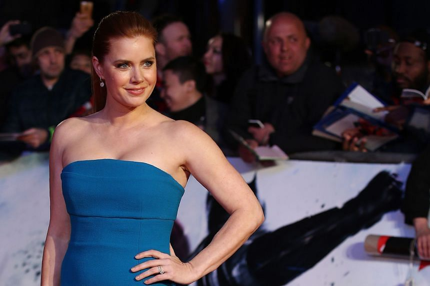 Ben Affleck, Amy Adams (above), Henry Cavill, Gal Gadot and other stars went ahead with Tuesday's London premiere of Batman V Superman: Dawn Of Justice, but skipped the traditional red-carpet interviews following the attacks in Brussels.