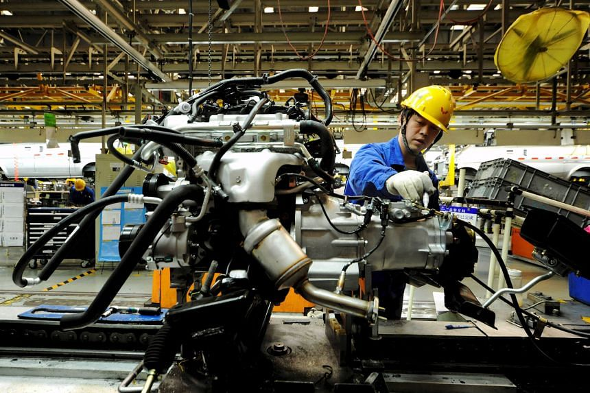 An automobile factory in China. Latest government data shows improving economic conditions in China, with fixed-asset investment rising and capital outflows moderating.