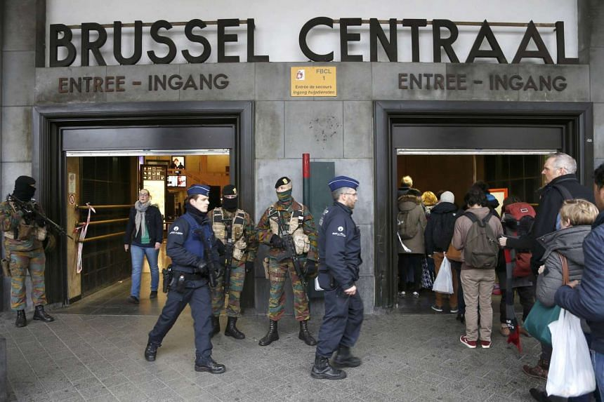 Police control the access to the central train station following Tuesday's bomb attacks in Brussels, Belgium, March 23, 2016.