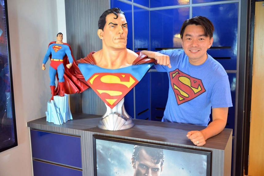 This photo shows Mr Eric Sia, 36, an administrative officer who has spent over $8,000 on his collection of Superman merchandise.