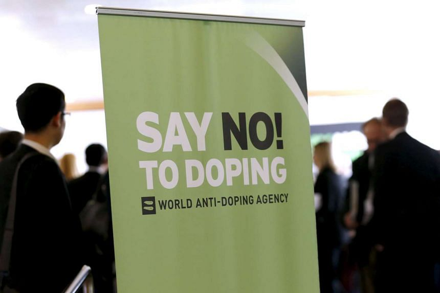 Participants talk before the start of the World Anti-Doping Agency Symposium for Anti-Doping Organizations in Lausanne, Switzerland, on March 24, 2015.