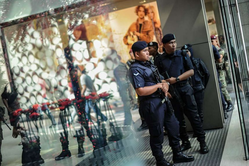 Malaysian police stand guard before the arrival of prime minister Najib Razak during a joint police-army exercise.
