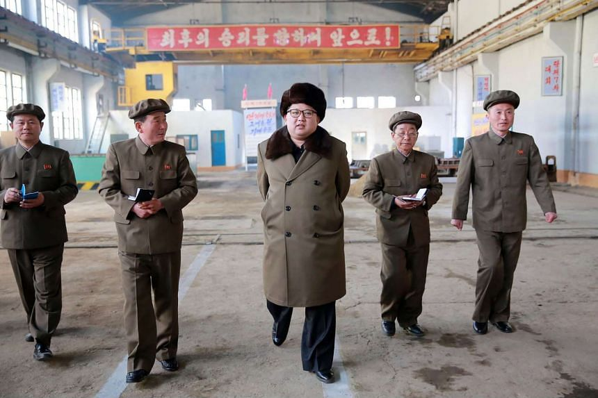 North Korean leader Kim Jong-Un (centre) inspects the February 11 Plant under the Ryongsong Machine Complex in North Korea in this undated handout.