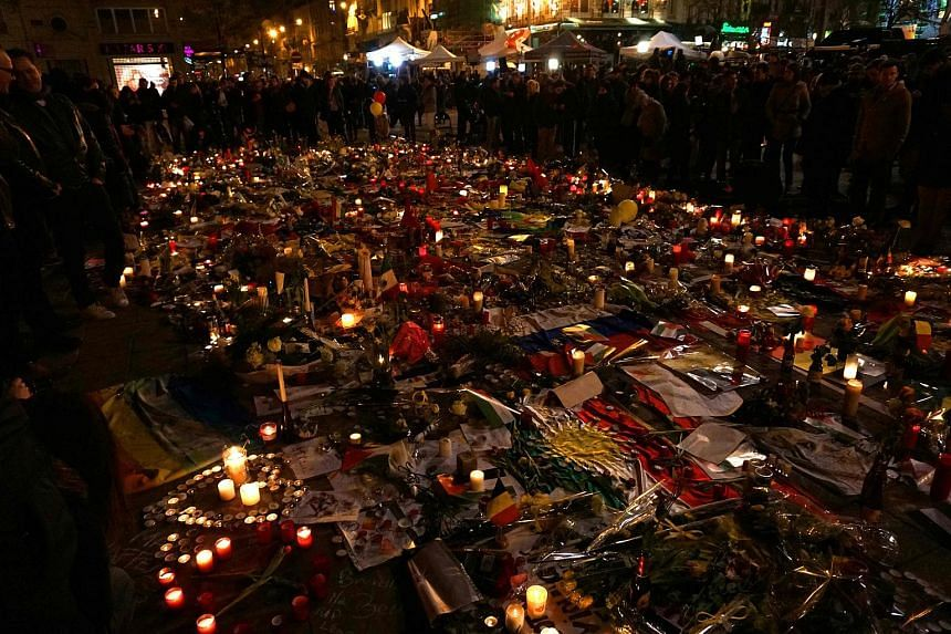 Candles are displayed in tribute to the Brussels attacks victims on place de la Bourse in Brussel, on March 24, 2016.
