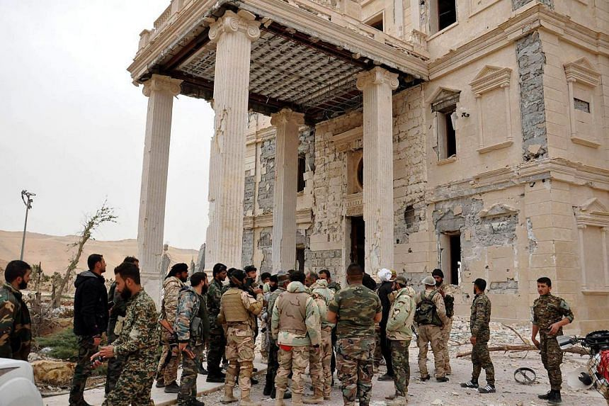 Syrian army units and local militias advancing further into the ancient city of Palmyra.