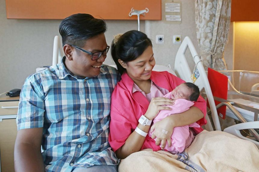 New parents Mohamad Sopian Hairi and Seri Hirdayu with their newborn daughter Liya Zafirah. They received Baby Bonus kits and leaflets on the Child Development Account First Step Grant from Mr Tan on March 25, 2016.