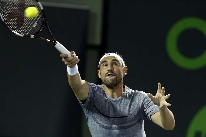 Marcos Baghdatis in action against Benjamin Becker during their first round match at the Miami Open tennis tournament on March 24, 2016.