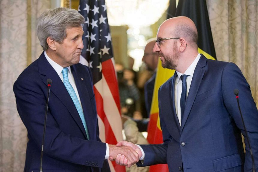 US Secretary of State John Kerry (left) shaking hands with Belgian Prime Minister Charles Michel in Brussels.
