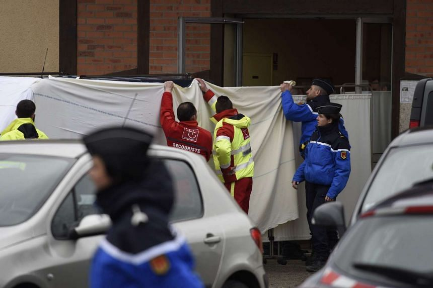 Funeral workers transfer bodies from the chapel of rest on March 25, 2016 in Montbeugny, central France to the hospital of Moulins, following an overnight accident between a minibus and a truck that killed 12.