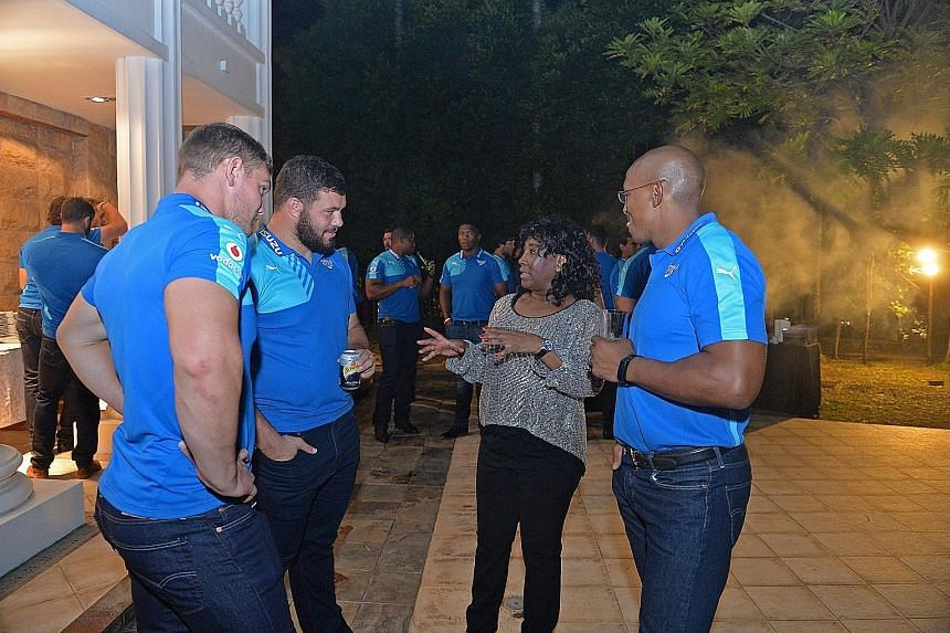 Members of the Bulls Super Rugby side with the High Commissioner of the Republic of South Africa, Hazel Francis Ngubeni, at a welcome function for the team at her residence yesterday. The Bulls play the Sunwolves tomorrow at the National Stadium.