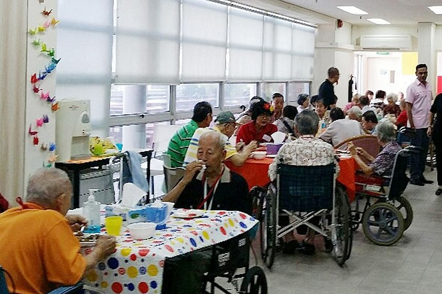 Samsui Supplies and Services staff and volunteers serving meals at the HCA Hospice Care headquarters last year. Samsui, a subsidiary of the Soup Restaurant Group, provides 2,000 meals a day to the needy, usually for free or at a minimal cost of about