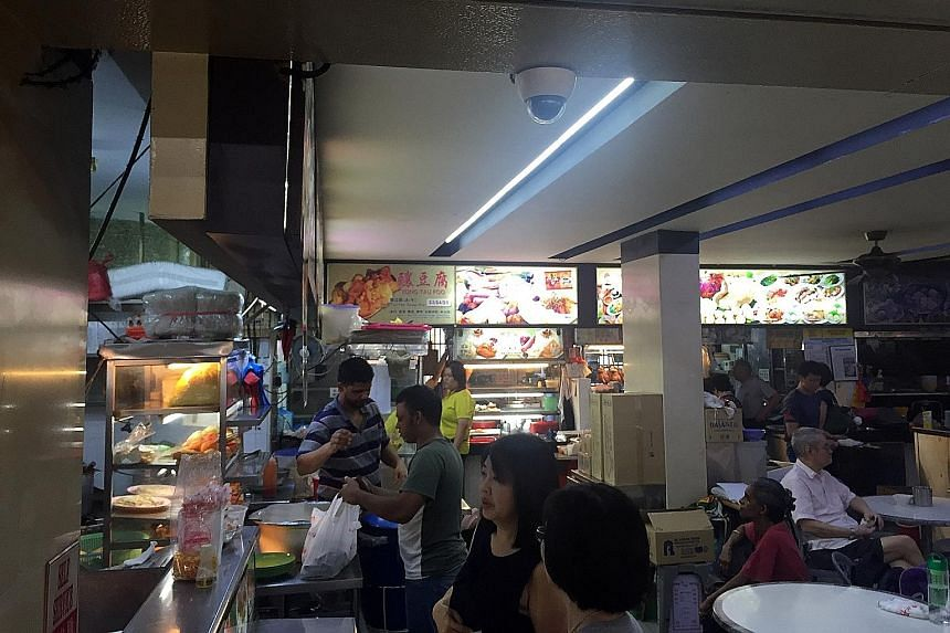 Chang Cheng Mee Wah Coffeeshop in Toa Payoh is one of about 400 coffee shops that have installed surveillance cameras (such as the one on the ceiling) as an added security measure in the wake of recent terrorist attacks in Europe.