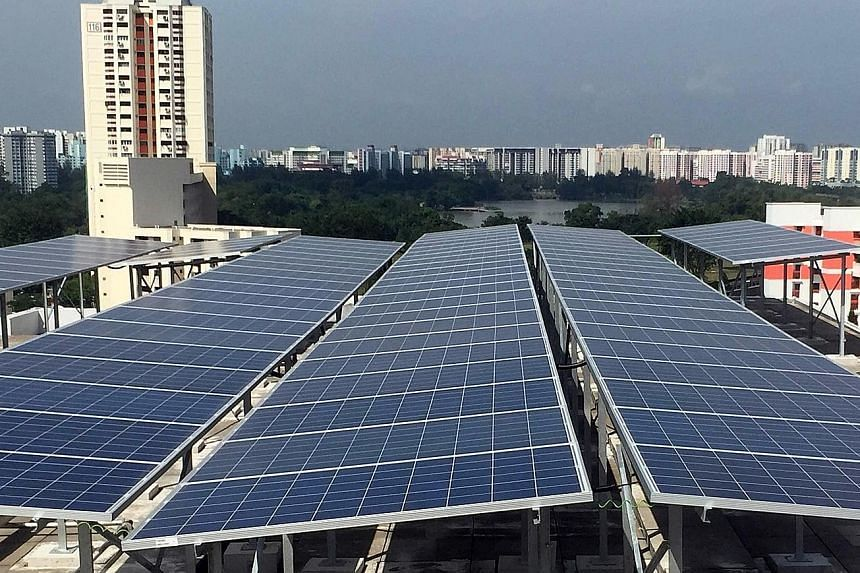 Solar panels atop an HDB block in Jurong. Once a swampland, the area has become a test bed for multiple technologies in recent years, like using solar energy to power common-area services like lights and lifts. An artist's impression of the Jurong In