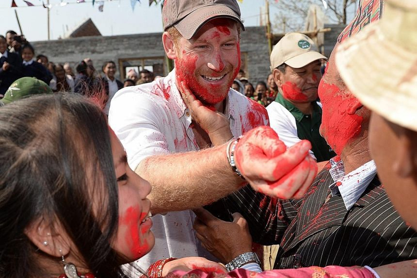 Britain's Prince Harry taking part in Holi, the Hindu festival of colours, while visiting the Gauda Secondary School in Okhari, in the foothills of the Himalayas, on Tuesday. The following day, the British royal, who was on an official six-day trip t
