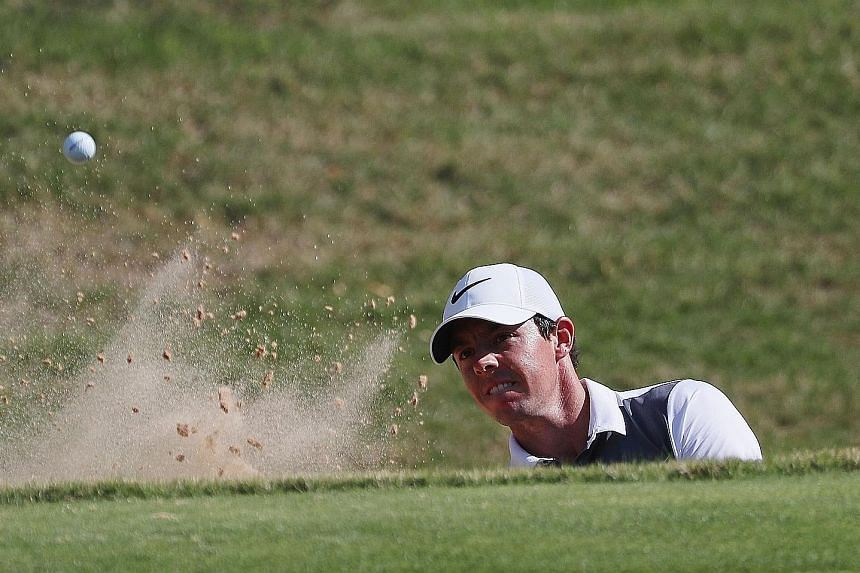 World No. 3 Rory McIlroy plays a bunker shot during the first round of the WGC-Dell Match Play. He beat Thorbjorn Olesen after coming back from two down with five holes to play.