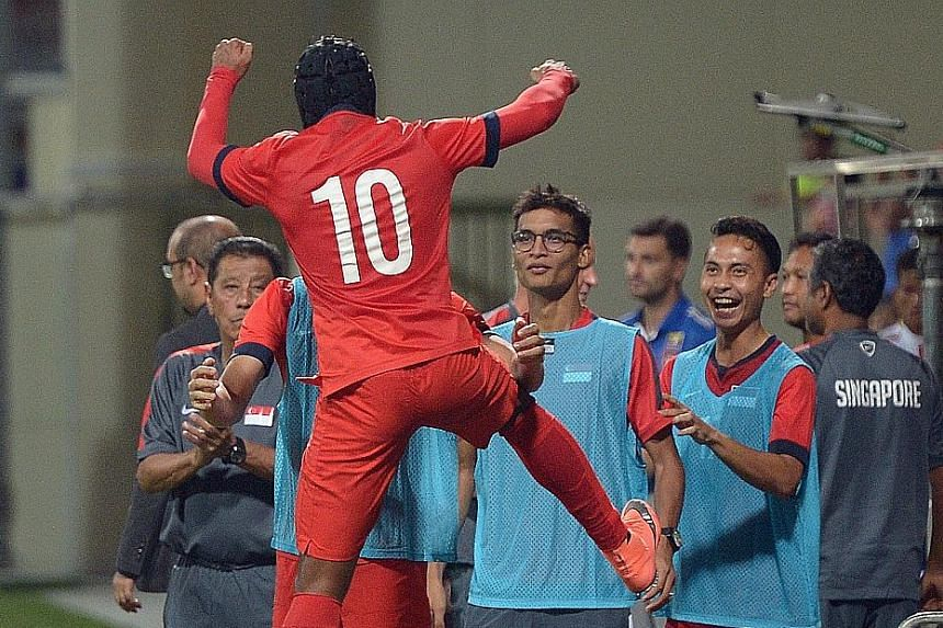 Fazrul Nawaz's leap for joy sums up the mood of the 2-1 win against Myanmar yesterday.
