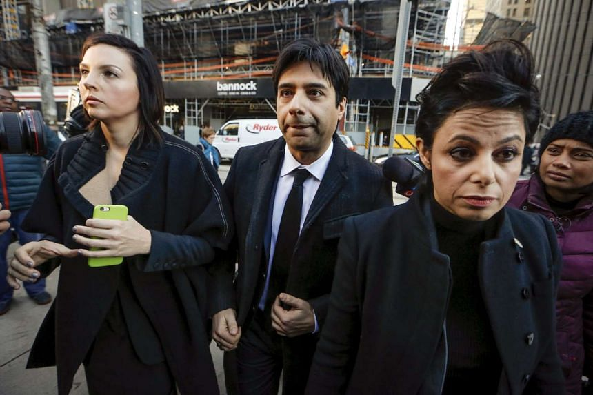 Jian Ghomeshi (centre) arrives for his first day of court alongside his lawyer Marie Henein (right), in Toronto, Feb 1, 2016.