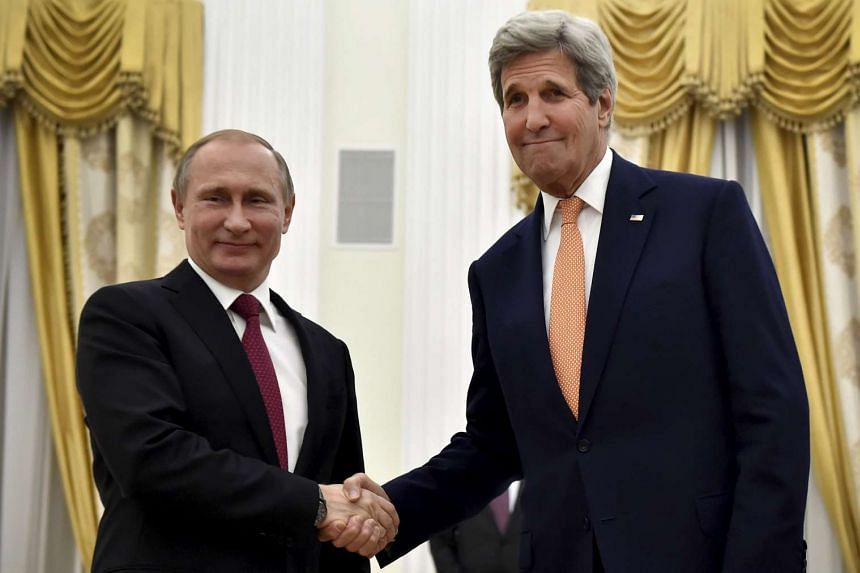 Putin (left)  and Kerry shake hands at the Kremlin in Moscow, Russia, March 24, 2016.