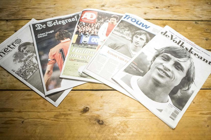 Dutch newspapers with front-page tributes to late Dutch football legend Johan Cruyff  on March 25, 2016.