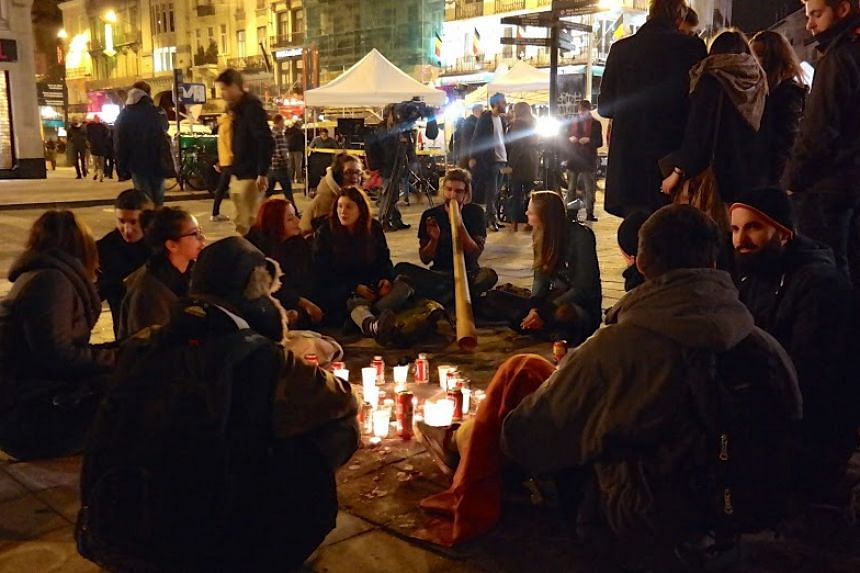 The square outside the century-old Brussels Stock Exchange building has become a meeting place after the attacks.