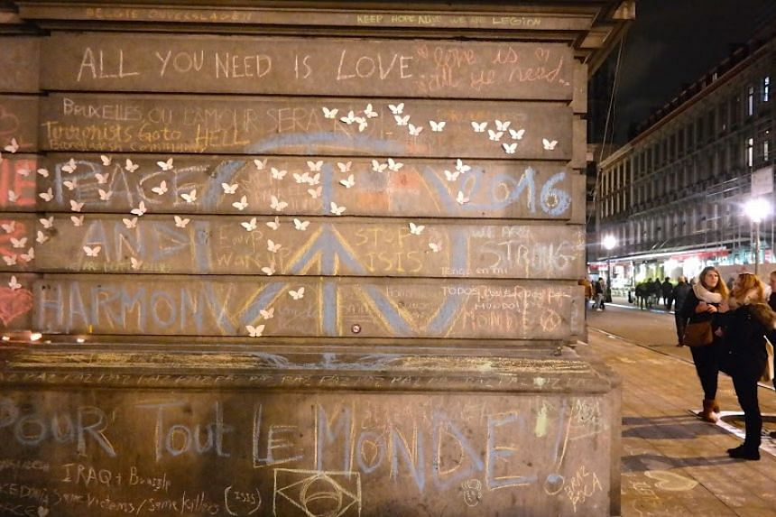 Messages of hope written in chalk on the walls of buildings.