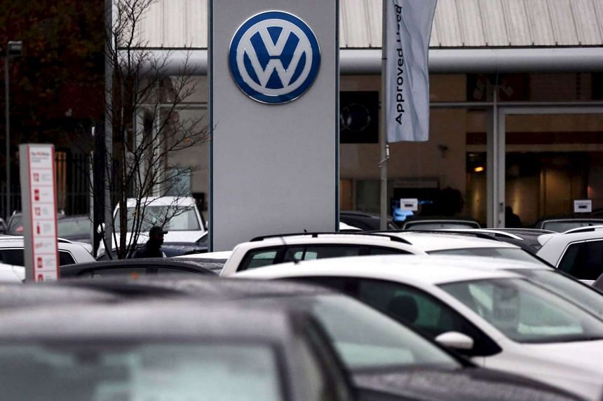 Volkswagen cars are parked outside a VW dealership in London, Britain.