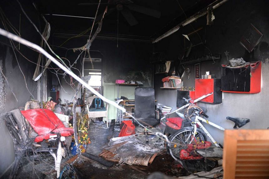 The charred remains after a fire razed a flat on the seventh storey of Block 318 Woodlands Street 31 at about 3.30am on March 6, 2016.