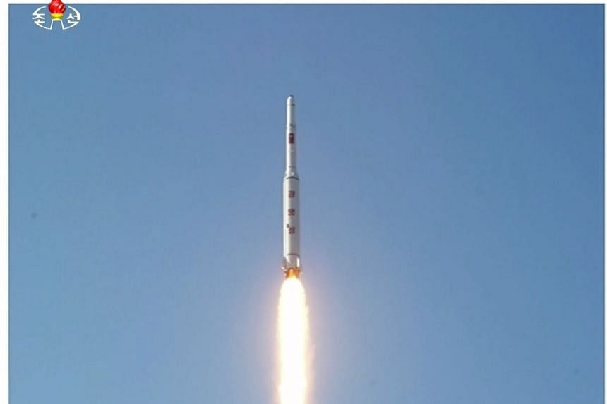 A North Korean long range rocket is launched into the air in a still image taken from video footage, released on Feb 7.