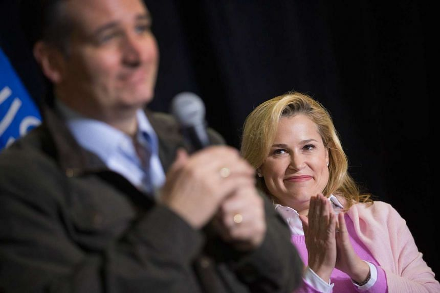 Heidi Cruz listens as her husband Republican presidential candidate Senator Ted Cruz speaks to workers at Dane Manufacturing during a campaign stop on March 24, 2016 in Dane, Wisconsin.