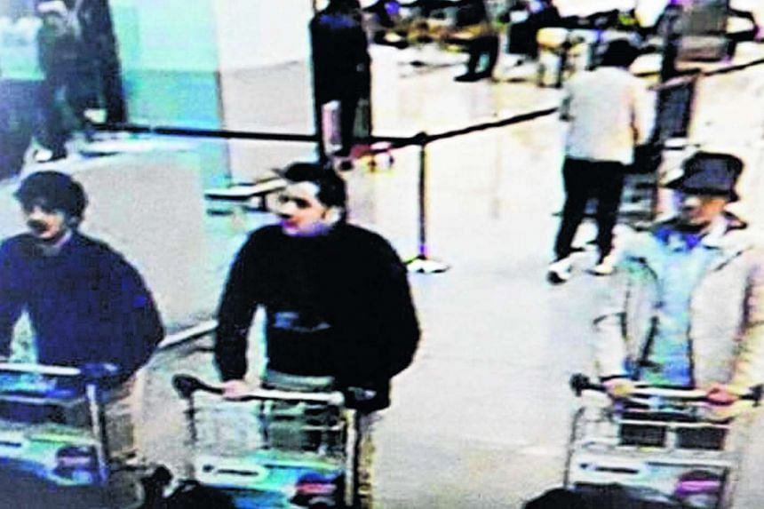 Belgian media have named Faycal Cheffou as the man (right) caught on CCTV footage with two Brussels airport bombers.