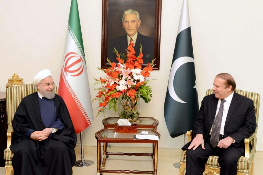 A handout picture released by the Press Information Department shows Iranian President Hassan Rouhani (left) talking with Pakistani Prime Minister Nawaz Sharif during their meeting in Islamabad, Pakistan, on March 25, 2016.