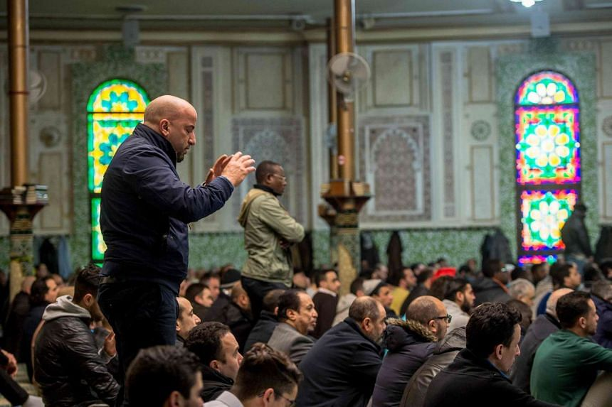 Muslims offer prayers at the Grand Mosque in Brussels on Match 25, 2016, as Muslims gathered for the first Friday prayers in the wake of the suicide attacks at Brussels airport and a metro station.
