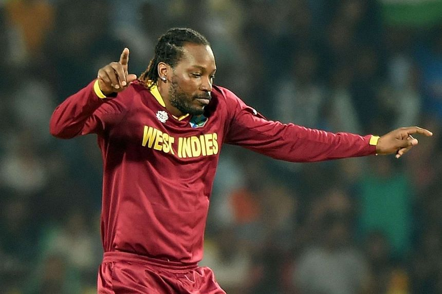 West Indies's Chris Gayle celebrates after taking the wicket of South Africa's batsman Rilee Rossouw.