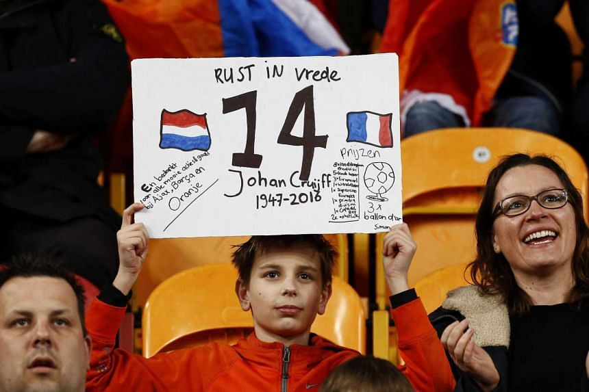 Fans commemorate Johan Cruyff during the friendly soccer match in Amsterdam on March 25 2016.