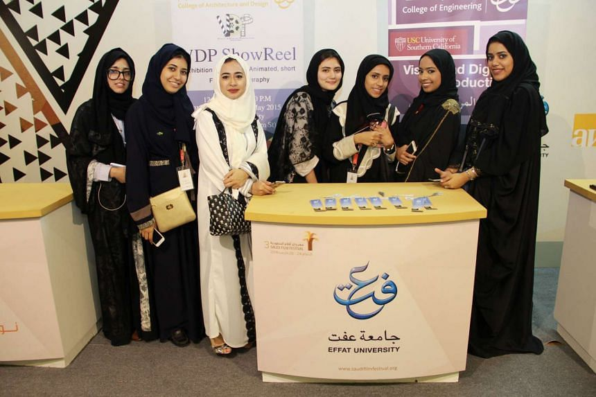 Saudi students from Effat University are seen at a booth promoting their Visual and Digital Production programme on March 24, 2016, at the Saudi Film Festival the Gulf coast city of Dammam.