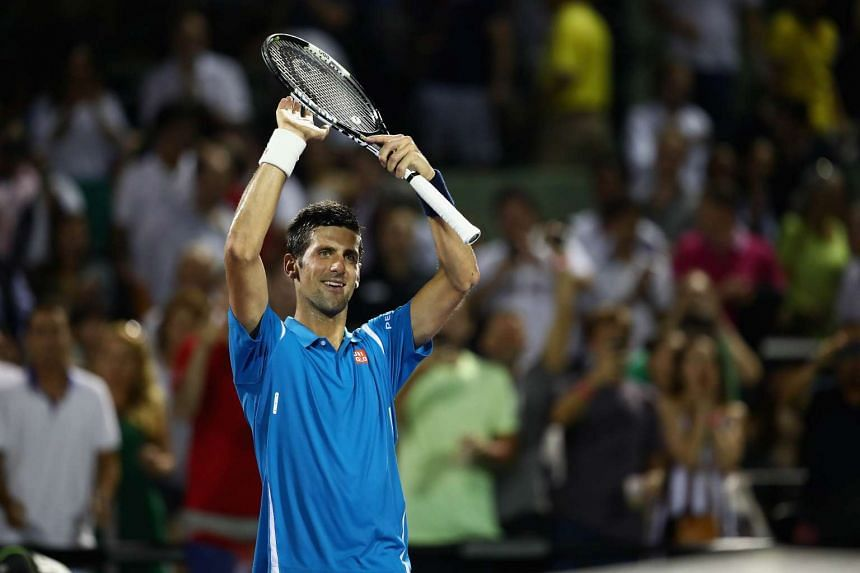 Novak Djokovic celebrates to the crowd after his straight sets victory against Kyle Edmund in their second round of the Miami Open.