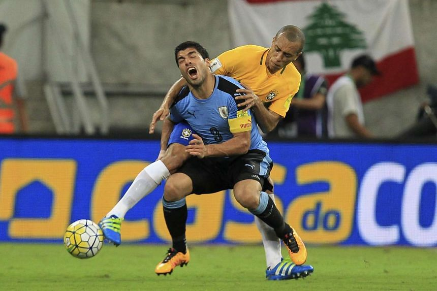 Joao Miranda (right) vies for the ball with Luis Suarez (left) during their Fifa World Cup 2018 qualification match between Brazil and Uruguay, on March 25, 2016.
