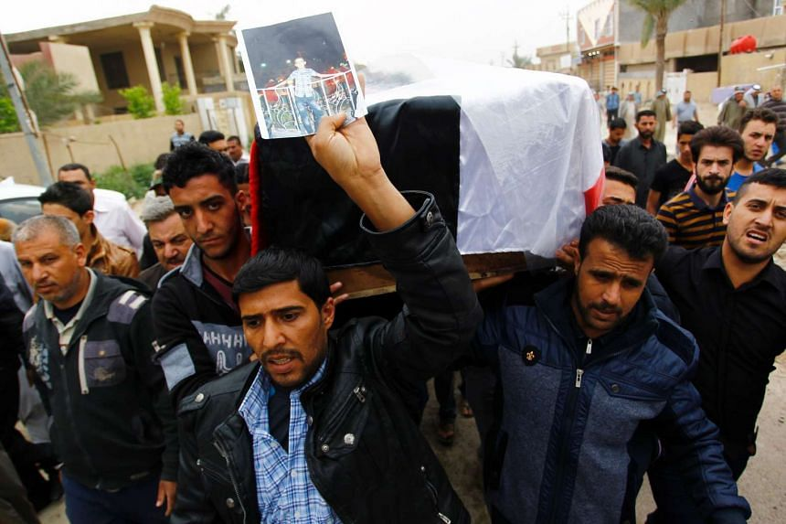 Relatives and friends carrying the coffin of one of the suicide bomb attack's victims.
