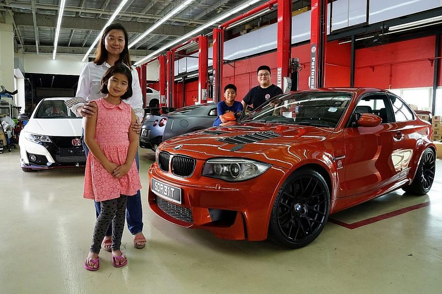 Ms Daphne Tan (with husband James Lee, son Maximus and daughter Melody) ferries her children to school in a BMW 1M.
