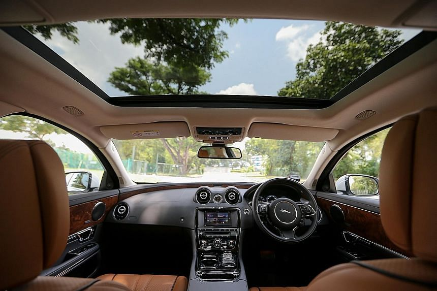 The Jaguar XJ 3.0 comes with a panoramic glass roof (above) and four-zone climate control that can be adjusted from the back seats (below).