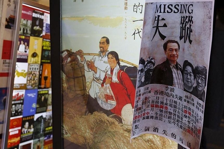 A printout of Mr Lee and his four colleagues, all of whom went missing in recent months, outside a bookstore in Causeway Bay, Hong Kong, in January. The four colleagues are now under criminal investigation in the mainland, linked to the trading of il