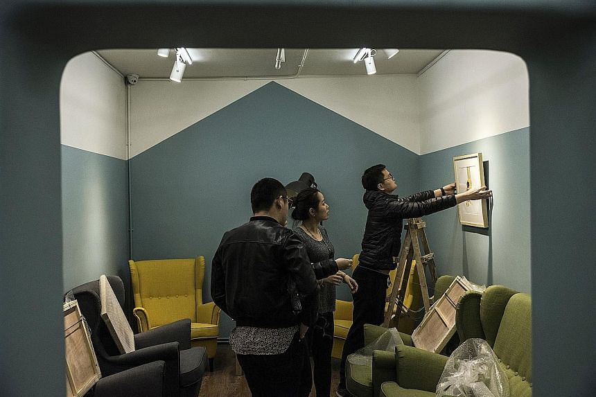 Ongoing preparations for an art exhibition at the Digua Shequ community centre in a former bomb shelter in Beijing.