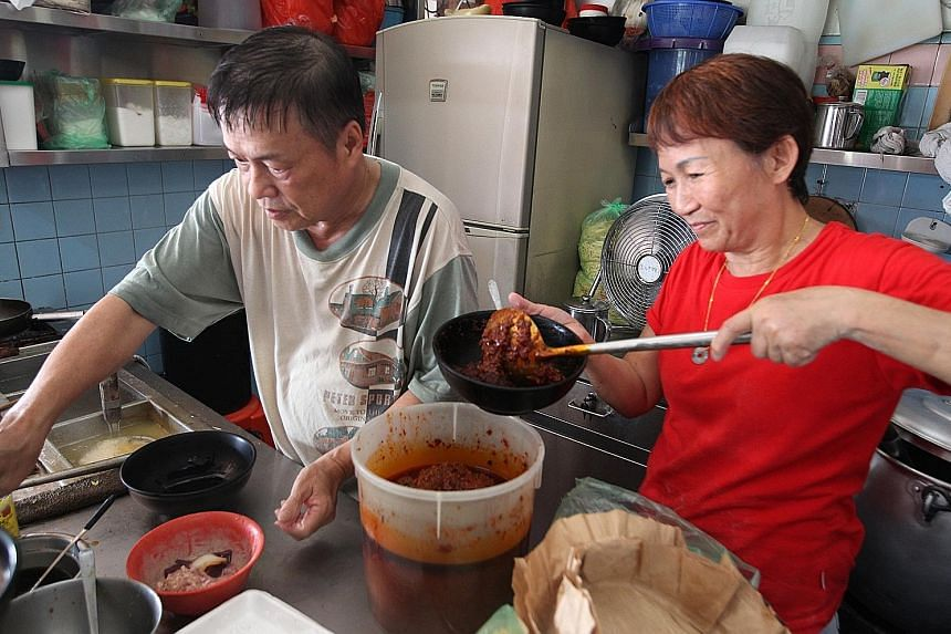Mr Yap and his assistant, Madam Chong, hard at work at his MacPherson Minced Meat Noodles stall. His trademark bak chor mee dish has been rated by several food websites as among Singapore's best.