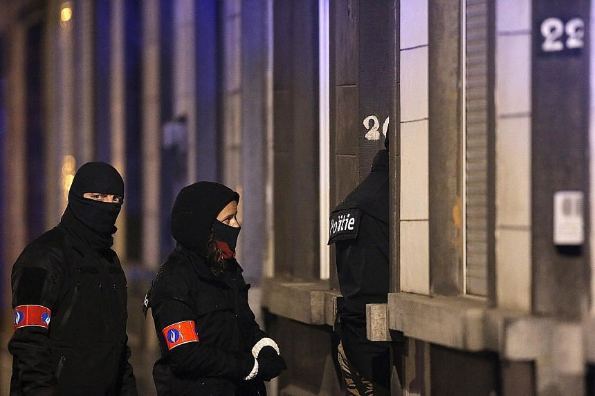"Police securing the entrance to a building in Schaerbeek during operations yesterday, following Tuesday's bomb attacks in Brussels. The operations came as France thwarted a deadly terrorist plot ""at an advanced stage"" with the arrest of a man in the"