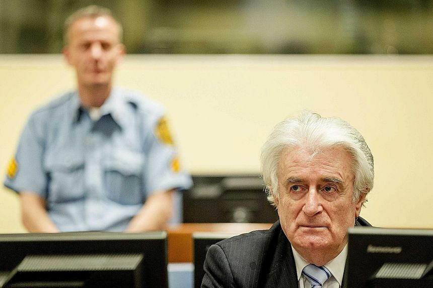 [ ]Karadzic in the courtroom in The Hague on Thursday. He is the most senior figure to date held to account for the ethnic cleansing campaign during the 1992-1995 civil war in the former Yugoslavia that left more than 100,000 people dead.