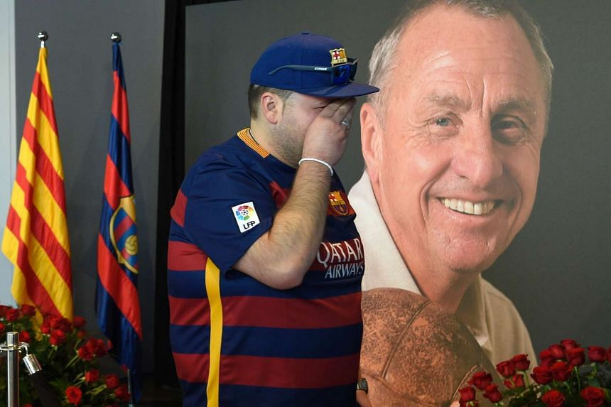 A Barcelona fan cries in a special condolence area set up at Camp Nou stadium for Johan Cruyff.