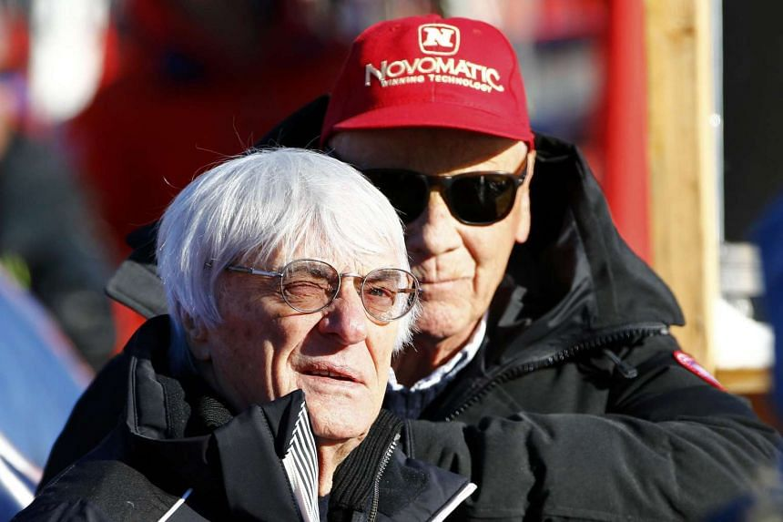 Formula One chief executive Bernie Ecclestone (left) reacting next to former Formula One champion Niki Lauda as they watch the men's Alpine Skiing World Cup Super G race on Jan 22, 2016.