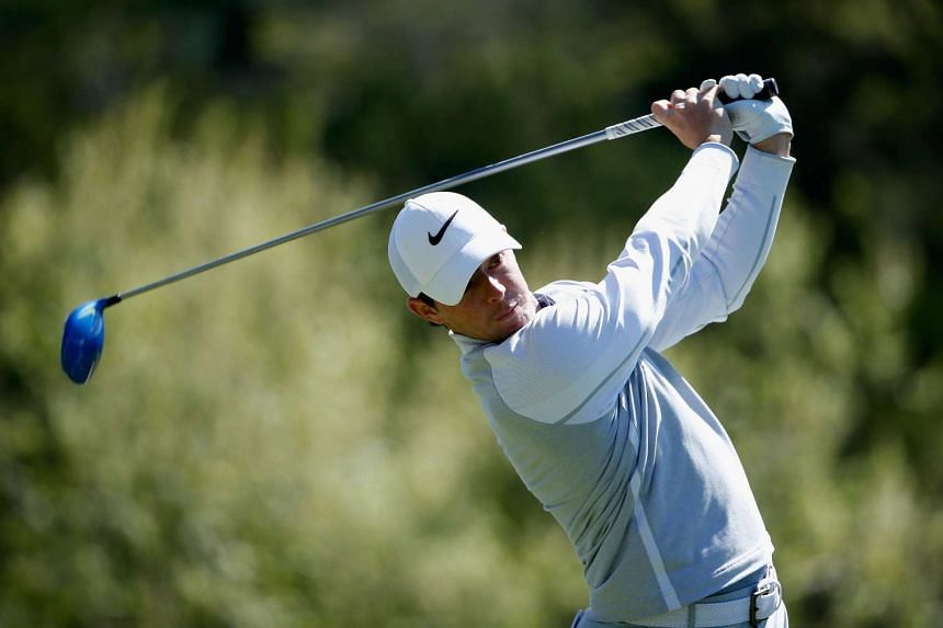 Rory McIlroy of Northern Ireland hits his tee shot on the third hole.