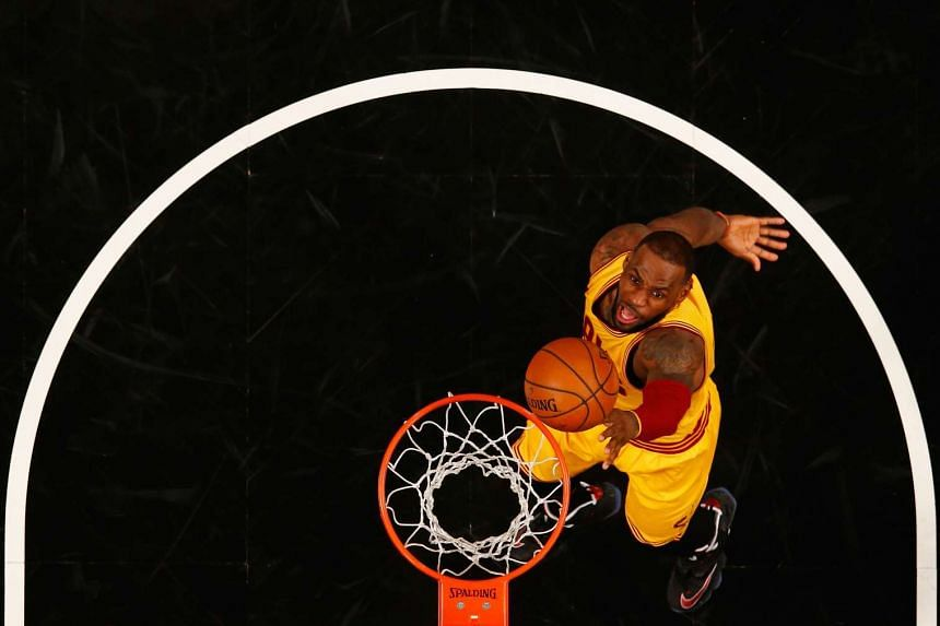 LeBron James of the Cleveland Cavaliers shooting against the Brooklyn Nets during their game on March 24, 2016.